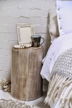 A tree stump as a side table | Glamour Coastal Living