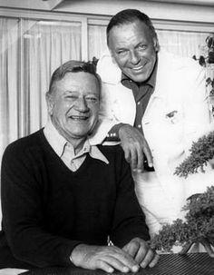 A light moment with legends John Wayne and Frank Sinatra.