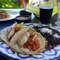 Photo of Fridas Mexican Beach House - Lahaina, HI, United States. Fish tacos and Maui Brewing coconut porter... perfect combo!