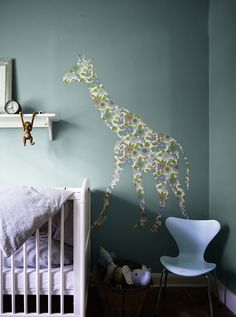 Sweet and Simple Danish Nursery - the soft blue green is a lovely colour for a nursery for boy or girl