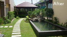 Strakke tuin met gras vijver stapstenen