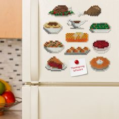 Use these fun food magnets on the fridge to indicate what's left of the Thanksgiving Feast—turkey, stuffing, pie, and more! Designed by Kyle McCoy.