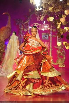 Bhawna Sharma showcases a creation by designer Ritu Beri on Day 4 of Delhi Couture Week, held in New Delhi, on August 03, 2013.