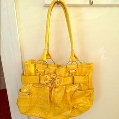 Purse Yellow purse great for spring. Only used a few times but very cute with spring outfits. Bags Shoulder Bags