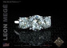 Three stone Old European cut diamond engagement ring by Leon Megé.