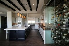 Kitchen with wine storage galore Staged by Revamp Professional Home Stagers #homestaging #homestagingscottsdale #homestagingPhoenix #realestatescottsdale #realestatephoenix #getrevamped #transitional #stagedtosell #supportlocal #localaz #localphx #phoenix #scottsdale #transitional #style #design  Revamp Professional Home Stagers  http://www.getrevamped.com