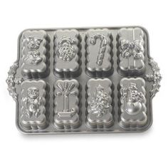 Bake up some holiday cheer with the Nordic Ware Holiday Mini Loaves Bundt Bakeware Pan. It features the best of the classic Bundt shapes and the even baking properties and fine details that only cast aluminum can provide. Mini Loaf Cakes, Mini Loaf Pan, Holiday Bread, Holiday Baking, Christmas Baking, Holiday Fun, Holiday Dinner, Festive Bread, Holiday Images