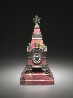 Kremlin Tower Clock, 1913, firm of Peter Carl Fabergé (Russian, 1846-1920). Rhodonite, silver, enamel, emeralds, sapphires.