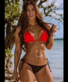 Great abs! Marvellous bikini body!! Love her! For more