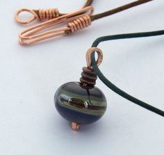Hey, I found this really awesome Etsy listing at https://www.etsy.com/listing/275579862/blue-purple-green-brown-striped-lampwork