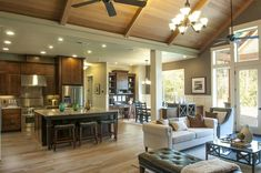Love the relationship between great room, kitchen, and nook. Wooden vaulted ceiling.  <3