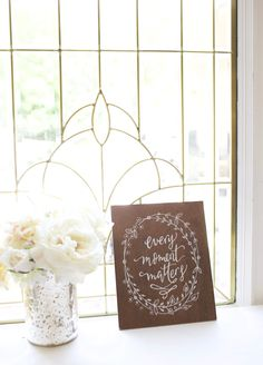 """Small dark stained plywood sign, hand painted """"every moment matters"""" with floral wreath detail. home decor. Rustic Wedding Signs, Rustic Wood Signs, Painted Signs, Hand Painted, Love Wood Sign, Baby Dedication, Guest Book Sign, Wedding In The Woods, Wedding Table Numbers"""