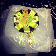 Lion king baby shower bow for the mother to be.