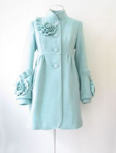 COMING SOON ~ This is our owner's favorite jacket OF ALL TIME. The vintage cut and flirty feel of the rosettes on the collar and cuffs will make ANYONE feel like a princess this winter. If pale blue is a little too summery for you, find this jacket in tweed, houdstooth, burgundy, black and many other solid colors. Available soon at Darcey's!