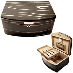 Provide the perfect storage for at least 100 cigars with this sturdy handcrafted humidor housed in a unique case. With an exterior made from high-gloss black wood veneer with white veins and shiny chr