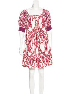 Orange, red and multicolor Gucci trapeze mini dress with square neckline, short sleeves, floral paisley print throughout and button closures at nape.