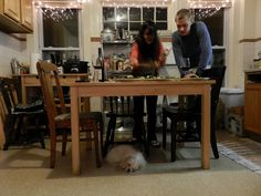 a few friends of mine preparing dinner in their apartment in Boston, Pepper the dog was keeping watch for any food that would fall from the table...even if she appears to be sleeping :)