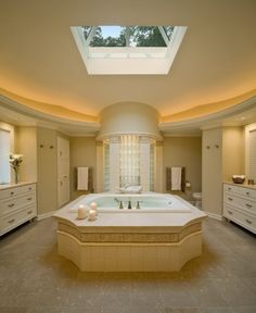 amazing bathroom with skylight. Now my tub needs a fireplace & a huge skylight for enjoying the cold weather outside while keeping my tootsies warm & my body relaxed. Just need a good book