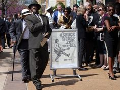 Chuck Berry fans pay their respects at a public open-casket memorial, St. Louis, Missouri.