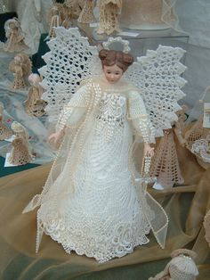 Hand-made Crocheted Angels with Porcelain Head made by cvmills@att.net
