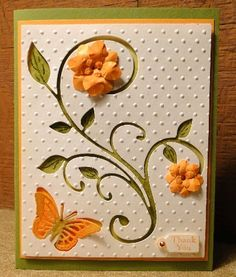beautiful handmade card ... organe dimensional flowers and butterfly on negative space leaf flourish with olive underneath ... luv the flow of this card ...