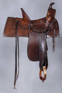 """W.B. Ten Eyck Montana Saddle A beautifully colored, and fine condition cowboy saddle. Well marked with W.B. Ten Eyck, Billings, M.T. cartouches on the skirts and seat. A solid 13 1/2"""" seat, 5 1/2"""" high cantle, and brass bound oxbow stirrups."""