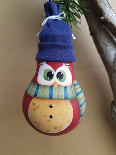 Whooo? Watt? This is a handpainted repurposed light bulb ornament! Each little owl is the perfect ornament to hang on your Christmas tree, and even after the holidays are over, this little guy will continue to warm your heart for the rest of those long winter months. Each light bulb is individually hand-painted, so though each owl is as cute as the last, no two are exactly the same! This particular ornament is painted with a lot of detail in shading, highlighting and linework. He is the…
