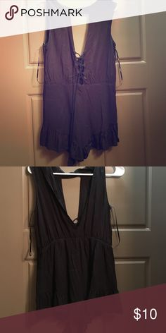 Lace up romper Lace up in the front romper! Size M from forever 21, too short on me Forever 21 Pants Jumpsuits & Rompers