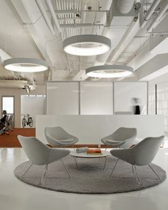 Collaborative spaces should be well defined. This one works because of shapes, flooring, and lighting that pulls your eye to the space.  We can help you with your office too! www.sdOfficeDesign.com