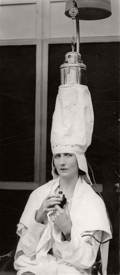 A woman demonstrates a hair-steaming apparatus at the...