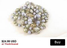#etsy #gotvintage #ecochicteam #vintage Lovely 1950s Japanese made multi strand bib necklace features four strands of pastel blue shades with gold accents and aurora borealis beads.