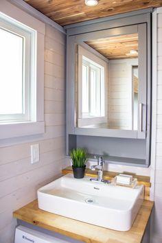 The bathroom sink and vanity.