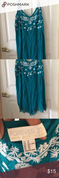 Turquoise Romper Super cute romper for F21. White decals along the top of the set and lace along the leg hemlines.  Selling for sister: pet-free and smoke-free.    Guarantees: Unless new with tags, I always wash items before shipment for a fresh smelling item! Will always let poshers know when I'm selling for others and their situation (pet home, smoking home, etc) Open communication throughout entire process. Forever 21 Other