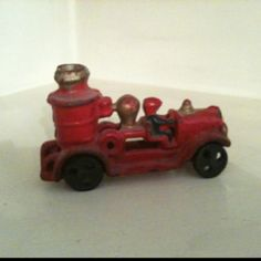 Antique wrought iron toy fire truck
