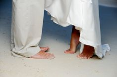 Removing shoes before the vows... represents holy ground (God commanding Moses to remove his sandals where He was because where God makes His presence known... is Holy!)