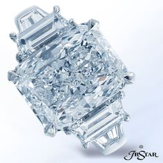 JB Star engagement ring features a 4.08ct radiant diamond center with trapezoid diamond sides and tapered baguettes on the shank.