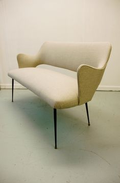 1950s Italian loveseat reupholstered in Bute wool. Matching chairs available.