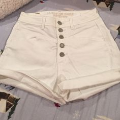 American eagle shorts White high waisted American eagle shorts with a lot of buttons, size 2! Never worn! American Eagle Outfitters Shorts Jean Shorts