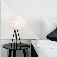 The Vita Eos mini lampshade from Hus & Hem is made from natural goose feathers, each carefully positioned on a paper core by hand.  As the lamp is shielded, the Eos radiates a soft and cosy glow, making it ideal to be hung from any height. Eos has a beautiful mesmerising elegance, even when not illuminated.