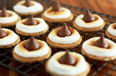 S'mores Bites – Two Ways > Cutting graham crackers into circles seems like a crumbly mess waiting to happen. Think I'll try it using 1/4 of a graham cracker & the 2 marshmallow halves side-by-side on it. (Happy coincidence that this would double the size of each serving - they are called S'mores for a reason!!!)