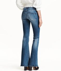 Dark denim blue. Shaping. Jeans in washed denim with technical stretch to trim and shape tummy, thighs, and seat, while jeans retain their shape. Regular