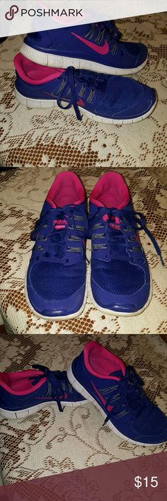 Blue and hot pink Nike tennis shoes Lightweight and in good condition. Nike Shoes Athletic Shoes