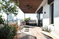 This duplex penthouse apartment with a big roof terrace in Tel Aviv was completely refurbished by local firm Toledano+architects for a family with children who wanted a chic and playful interior.