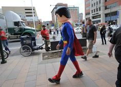 Gen Con fan Josh Leatherman of Illinois, dressed as a Lego Superman, walks down Capitol Avenue Friday afternoon. Gamers moved about the city while grabbing lunch and taking in the sights on day 2 of the Gen Con convention held at the Convention Center in downtown Indianapolis on August 16, 2013. Matt Detrich / The Star