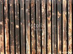 Verwitterte alte braune Holzlatten mit Patina als Fassadenverkleidung eines Restaurants in Münster