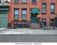 stock-photo-brownstone-home-with-green-awning-pink-petunias-and-trash-cans-lined-up-behind-rod-iron-fence-in-151017077.jpg (450×358)