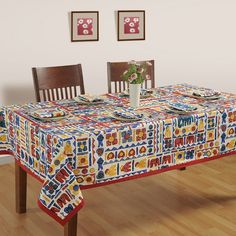 Get designer jaipuri essence dining room table cover from online shopping portal of saavra. Covers having rich indian colors that will add a royal look to your dining Space.