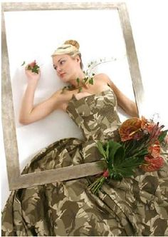 camouflage wedding dress - if I have a renewal of vows ceremony, I may have to get a dress like this.  :)