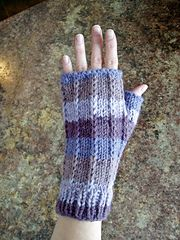 Slipped stitches add dimension to these soft and comfy fingerless mitts.