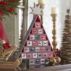Advent Calendar Tree | Count down the days to Christmas with this charming wooden Advent tree. Place a small gift or treat in each of the twenty-four drawers.